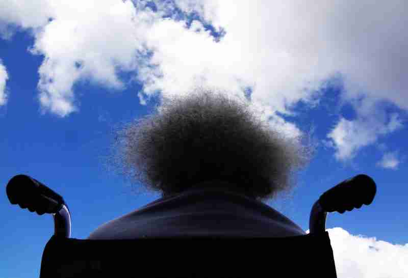 woman wheelchair looking at sky